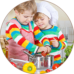 Two cute little kid boys cooking italian soup and meal with fres